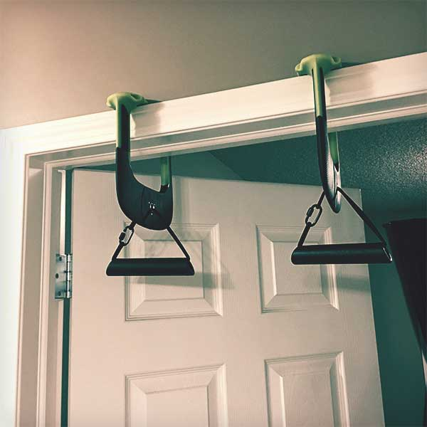 Duonamic's Eleviia modular travel pull-up system camped to a doorway.